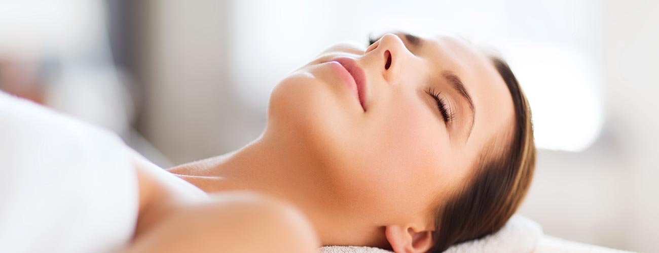 Reclining, relaxed woman is ready for a spa treatment