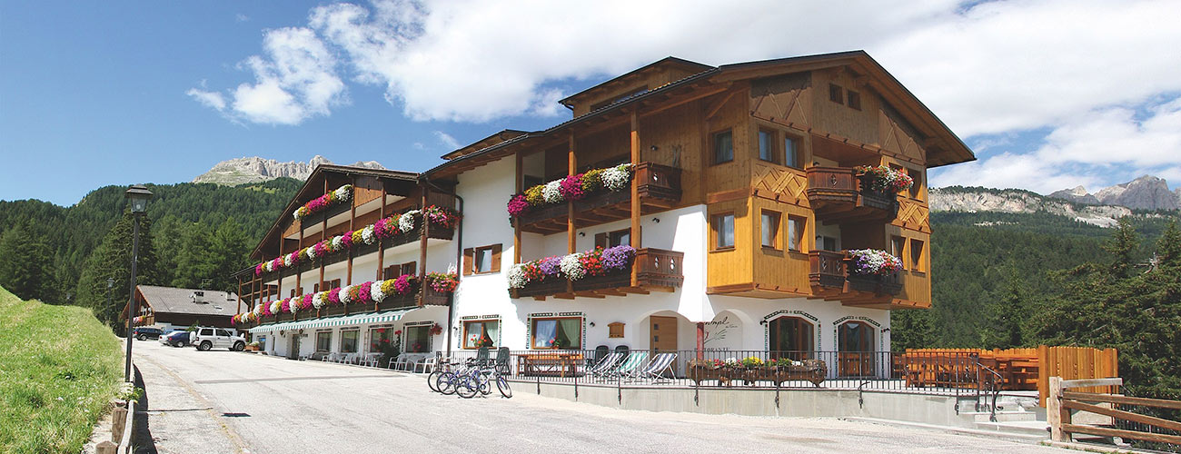 Outside view of the Hotel Gran Mugon in Fassa Valley