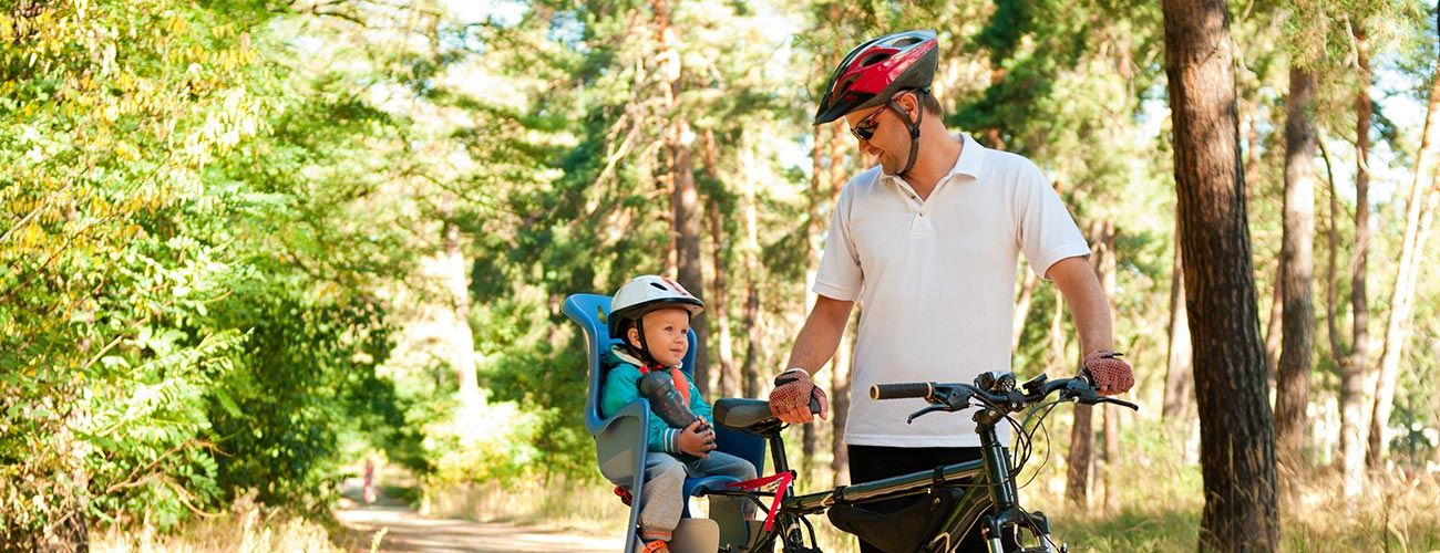 Father with child on a mountain bike