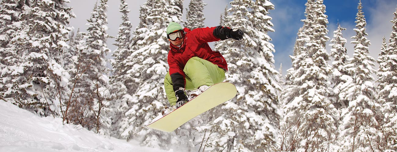 A snowboarder jumping